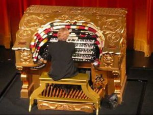 The gold Wurlitzer organ in use